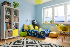 Child,Room,With,A,Bookstand,,Bed,,Chair,,Pouf,And,Big